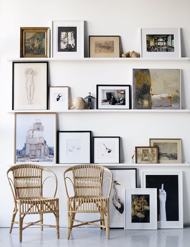 leaning gallery wall stacked book shelf framed prints art wall decor photo